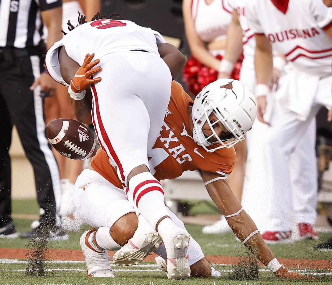Texas Longhorns defensive back Darion Dunn (4) forces Louisiana-Lafayette Ragin Cajuns safety Percy Butler (9) to fumble in the fourth quarter at DKR-Texas Memorial Stadium in Austin, Saturday, September 4, 2021. Texas recovered the ball. (Tom Fox/The Dallas Morning News)
