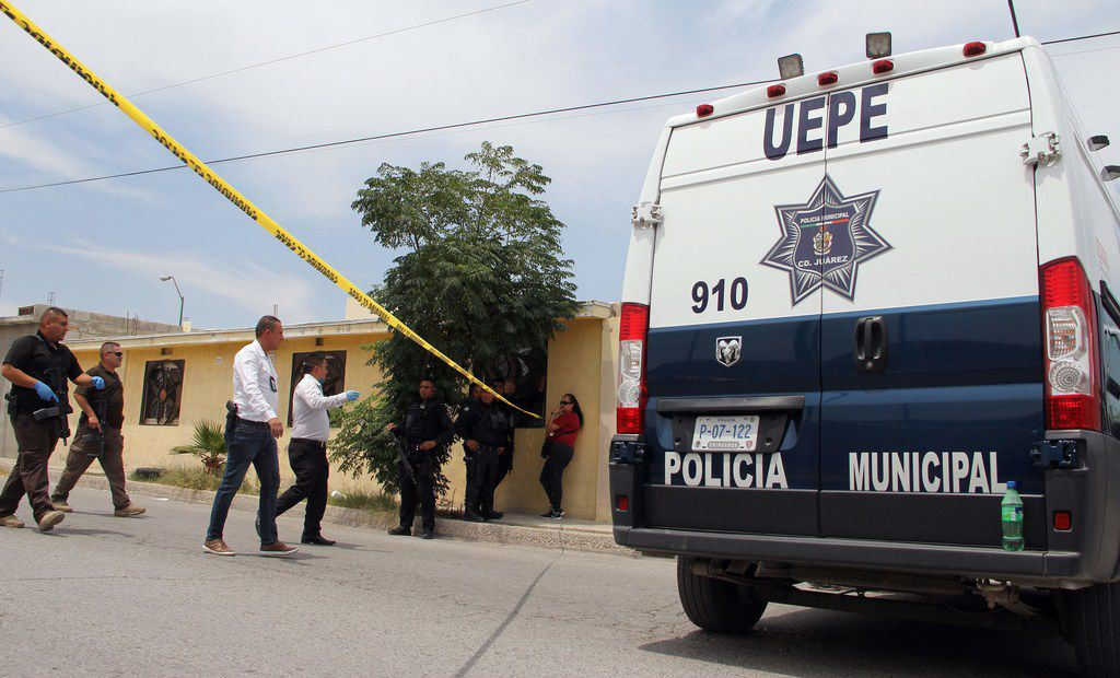 Forensic experts and policemen arrived at the crime scene, after the bodies of 11 people were found inside a house in Ciudad Juarez, Mexico, on Friday.