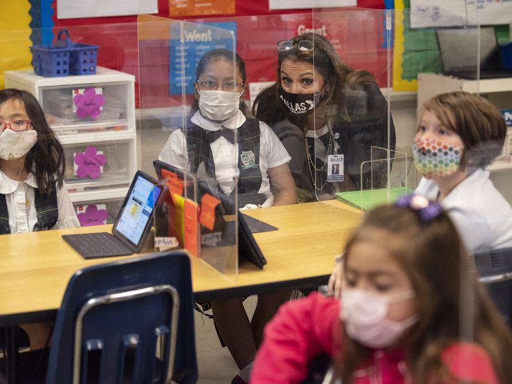 Susana Cordova, DISD deputy superintendent, speaks with second grader Kaylee Rosas about her class assignment during a tour of Tom Gooch Elementary School.