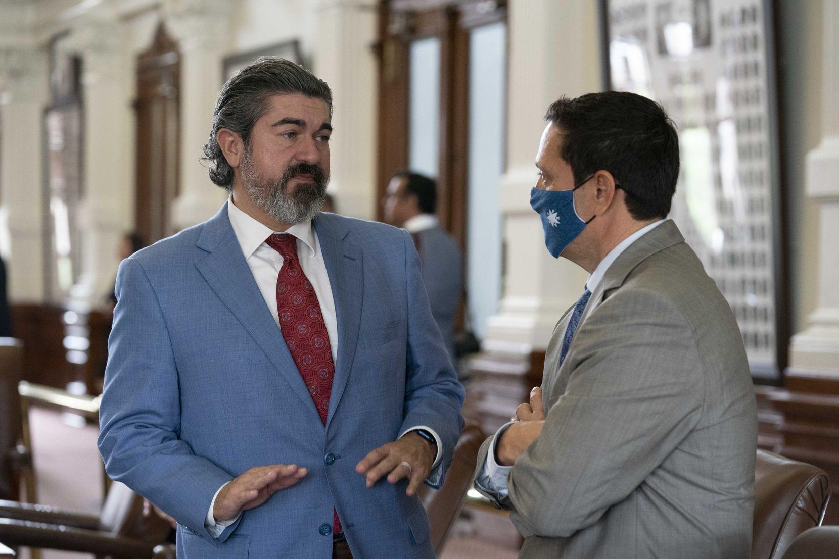 Rep. Eddie Rodriguez, D-Austin, (left) talked with Rep. Trey Martinez Fischer, D-San Antonio, on the final day to pass bills in the 87th Texas Legislature.
