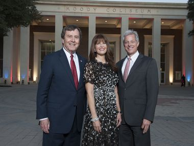 From left: SMU president R. Gerald Turner, Francie Moody-Dahlberg and Ross Moody celebrated the renovation of Moody Coliseum at SMU in December 2013.
