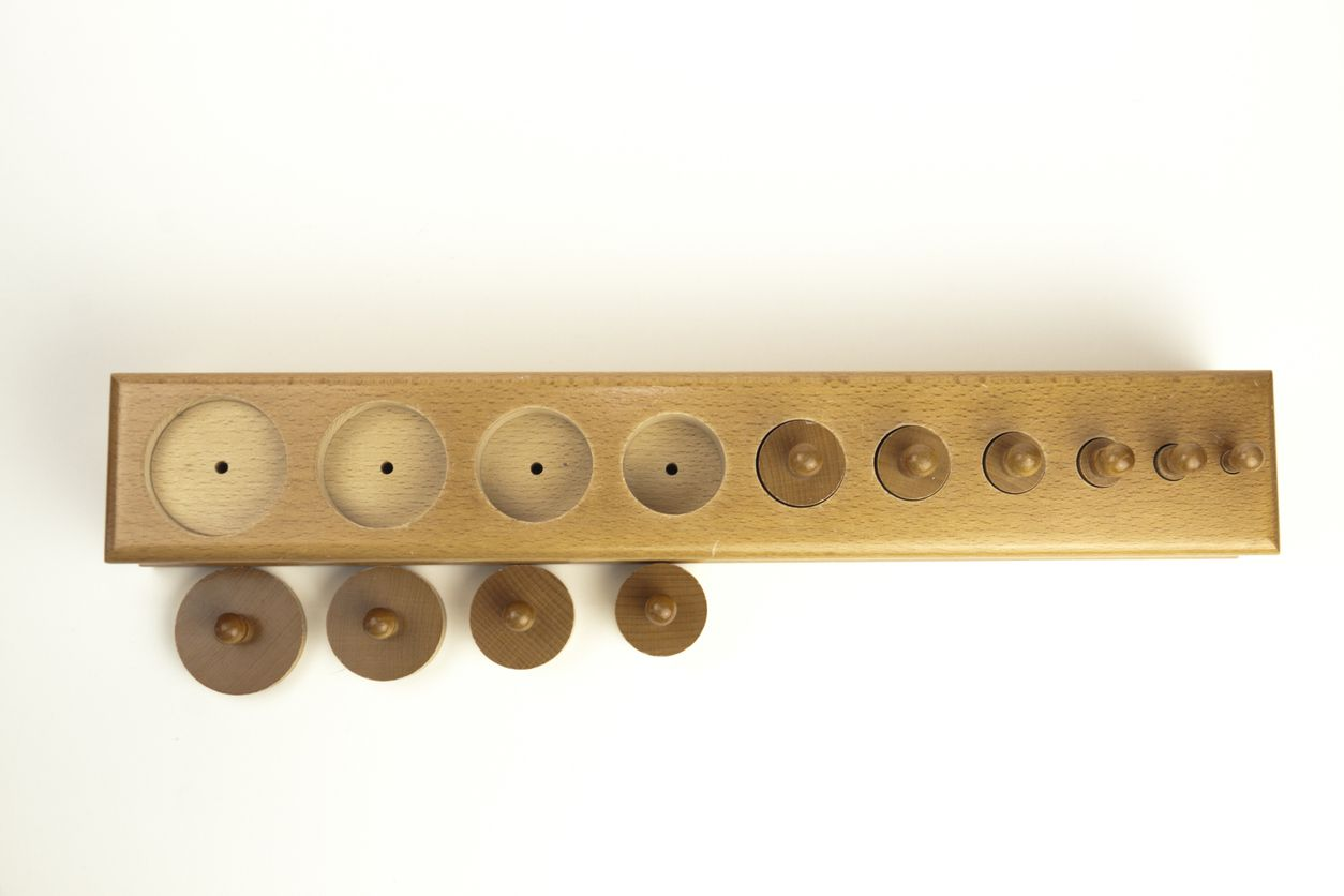 Montessori sensory equipment. Graduated Cylinders with Knobs.