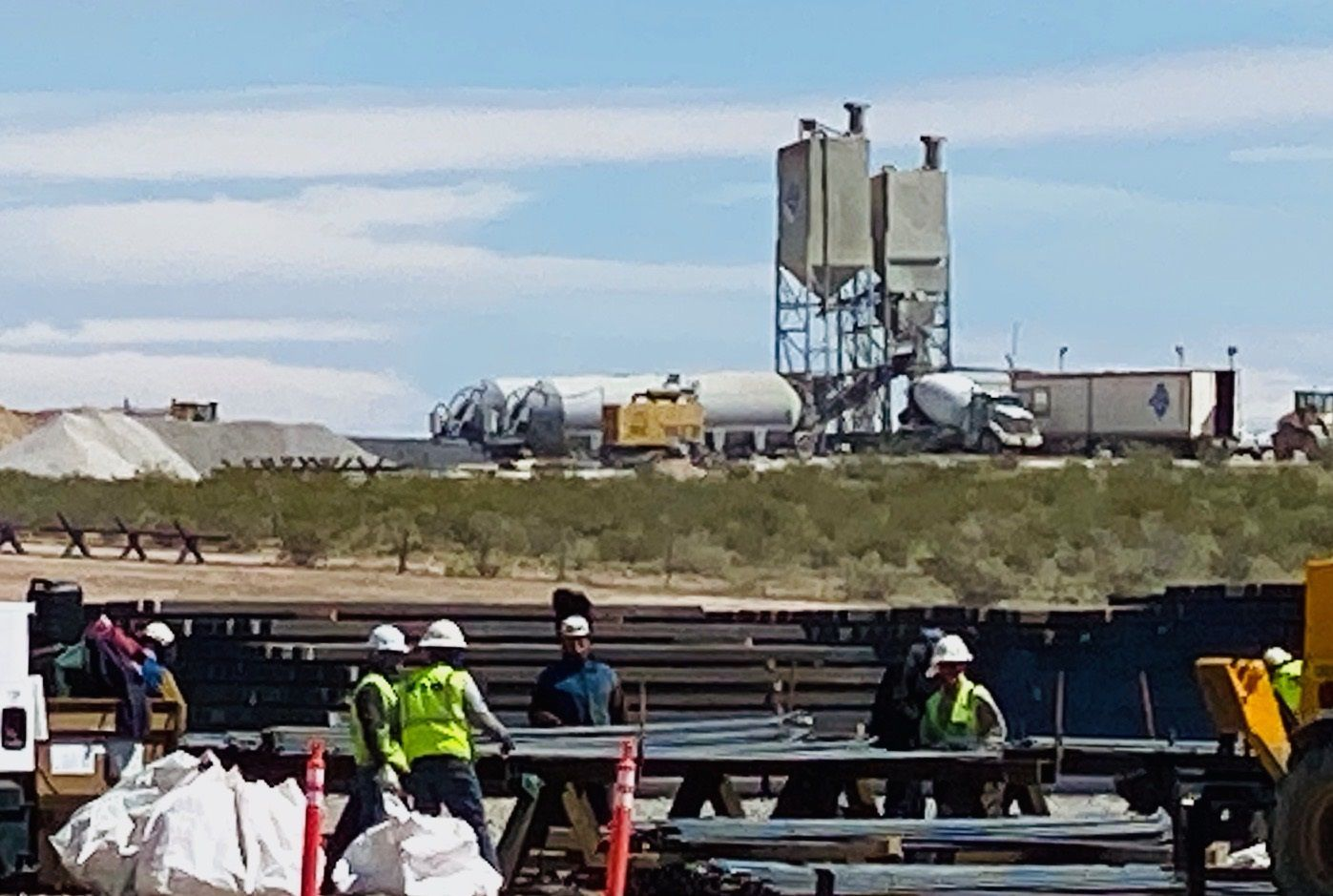 Construction of President Donald Trump's border wall continues as workers defy safe-distancing guidelines set by the White House to halt the spread of coronavirus. Here, clusters of workers toiled on April 1, 2020, just across the Texas border along Highway 9, between El Paso and Columbus, N.M.