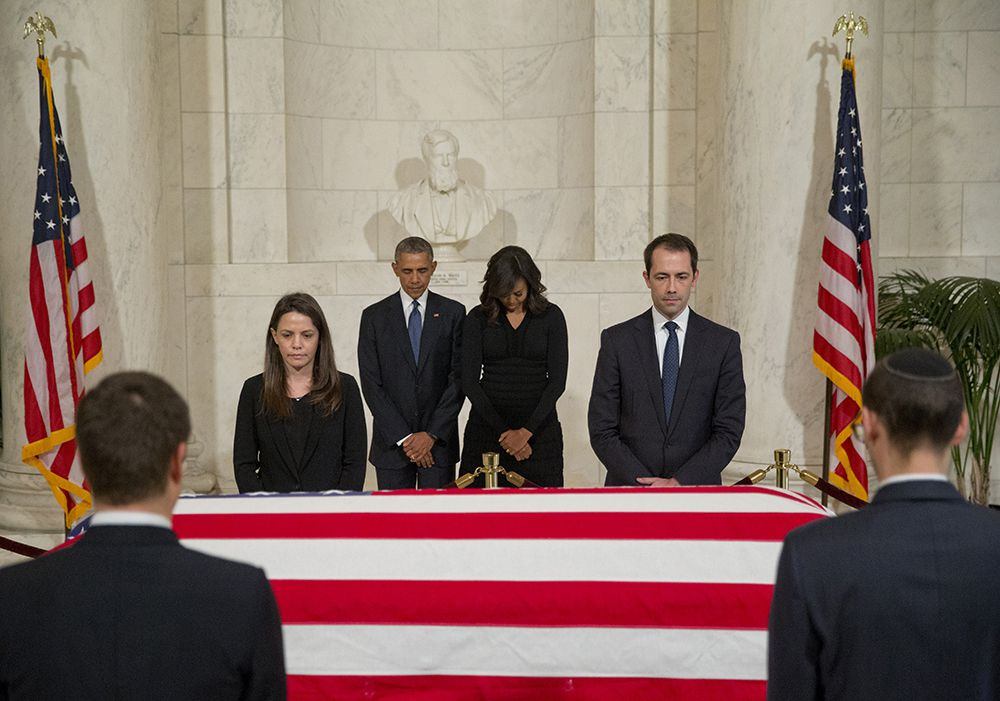 President Barack Obama and first lady Michelle Obama pauses as they pay respects beside the casket of Associated Justice Antonin Scalia as it lies in the Great Hall of the Supreme Court, in Washington, Friday, Feb. 19, 2016. (AP Photo/Pablo Martinez Monsivais)
