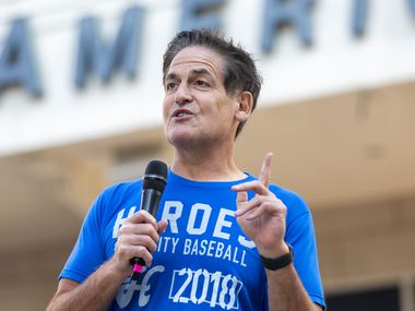 """FILE - Mavericks owner Mark Cuban welcomes attendees for a """"Courageous Conversations"""" meetup to discuss systemic racism at Victory Plaza outside American Airlines Center in Dallas on Tuesday, June 9, 2020. The Mavericks hosted the event with all team employees, including players and coaches, to discuss systemic racism and disparities facing the African American community."""