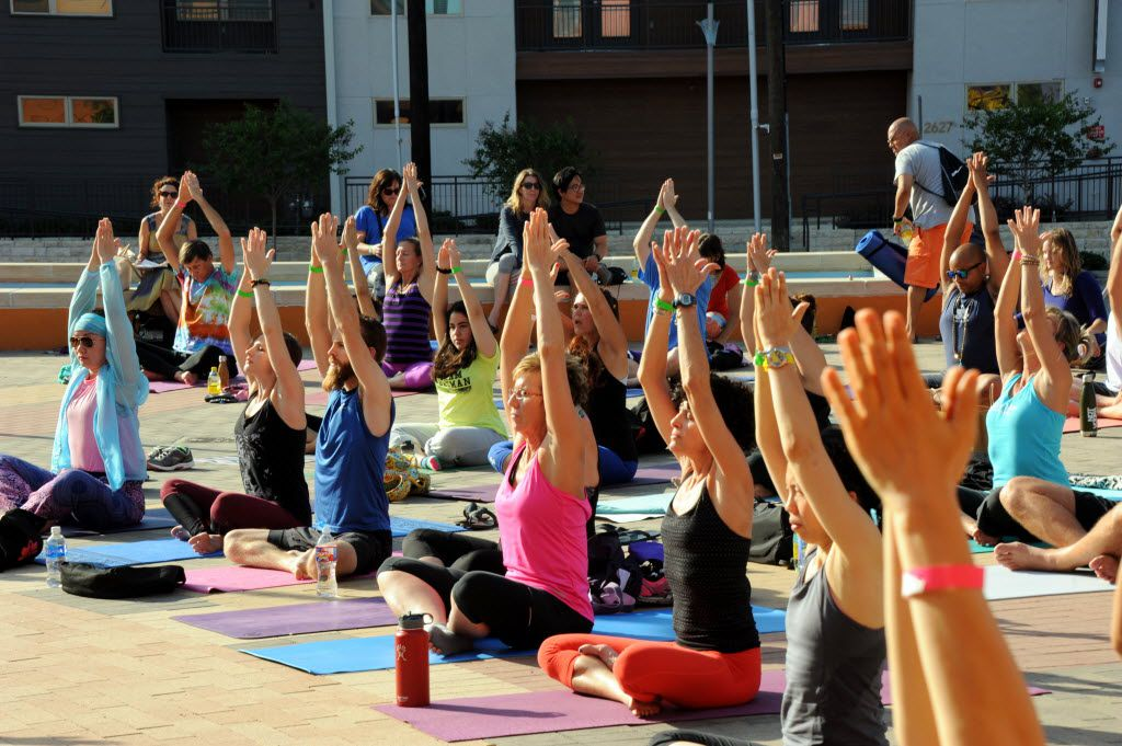 The session starts with the easy pose at the D-FW Free Day of Yoga Kickoff at the Latino Cultural Center in Dallas, TX on September 3, 2016. (Alexandra Olivia/ Special Contributor)