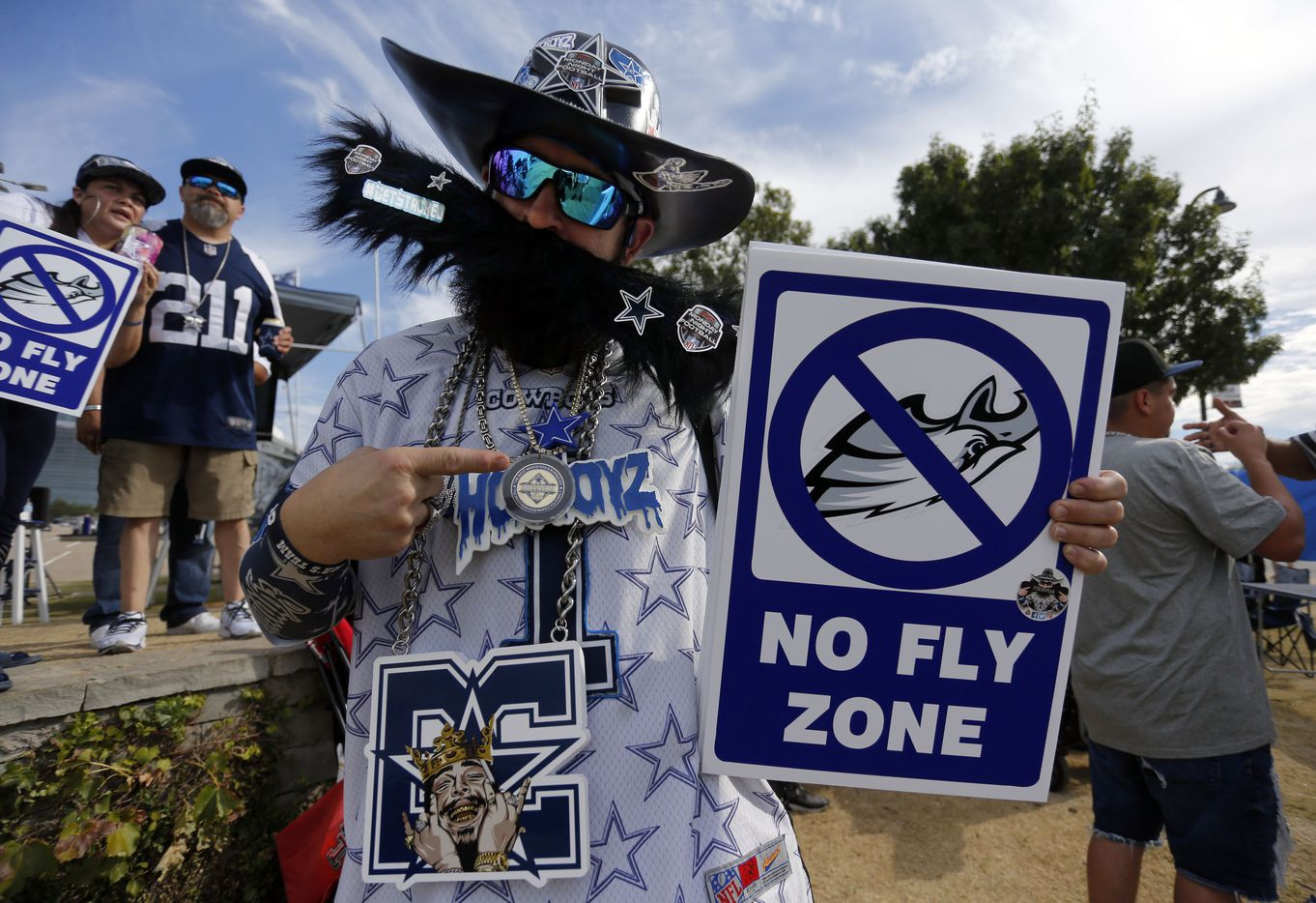 """Dallas Cowboys fane Kevin Stacheman, of Friso, displays his """"No FlyZone"""" sign (meaning the Philadelphia Eagles' passing game will be thwarted tonight), while tailgating before a NFL football game between the Dallas Cowboys and the Philadelphia Eagles High at AT&T Stadium in Arlington on Monday, September 27, 2021. (John F. Rhodes / Special Contributor)"""