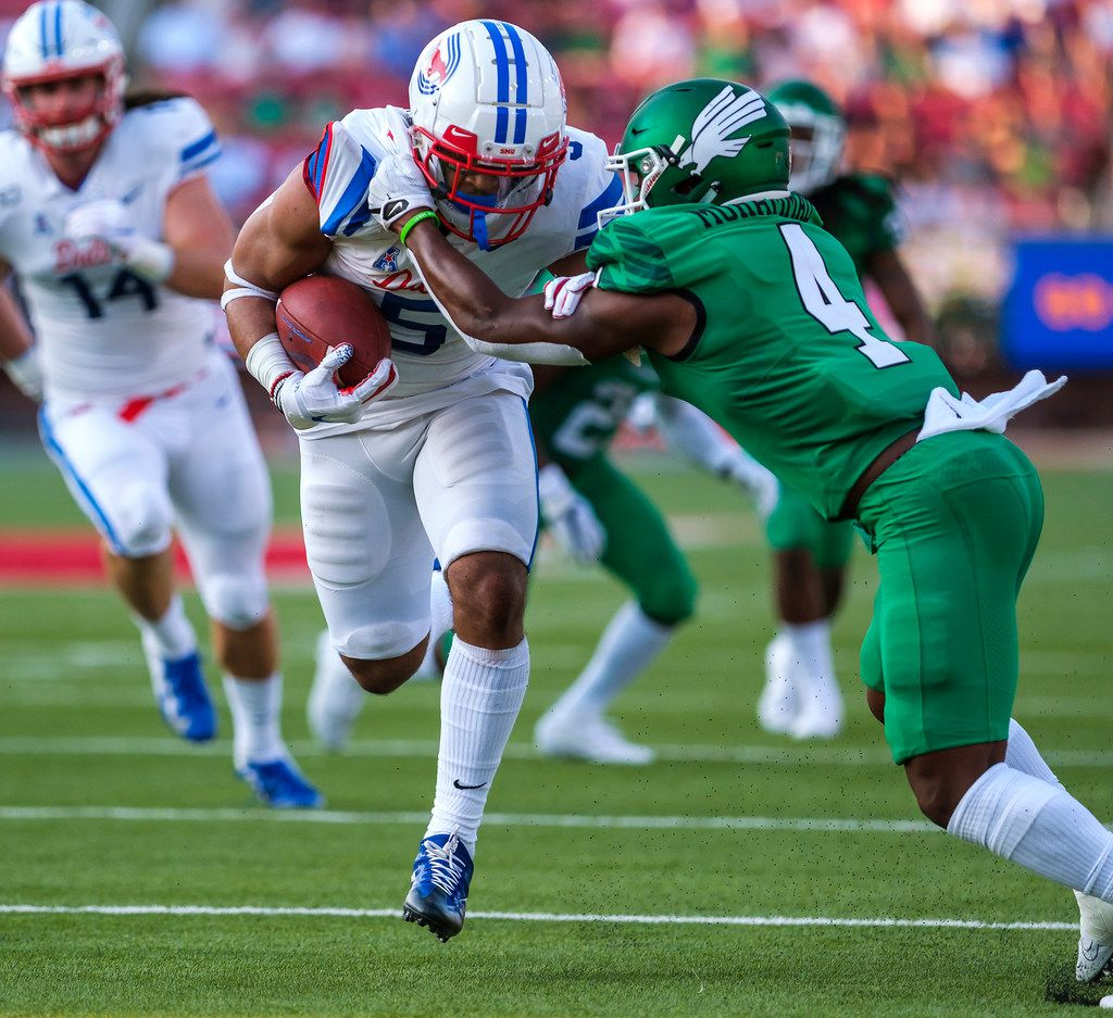 SMU running back Xavier Jones (5) gets past UNT safety Khairi Muhammad (4) on a 24-yard touchdown run during the first half of an NCAA football game at Ford Stadium on Saturday, Sept. 7, 2019, in Dallas. (Smiley N. Pool/The Dallas Morning News)