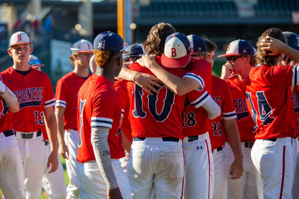 McKinney Boyd's Beau Brewer (10) is consoled by teammate junior Jack Hagan (18) after their loss to Fort Bend Ridge Point at their 6A UIL baseball state semifinals game at the Dell Diamond on June 7, 2019 in Round Rock, Texas. (Thao Nguyen/Special Contributor)