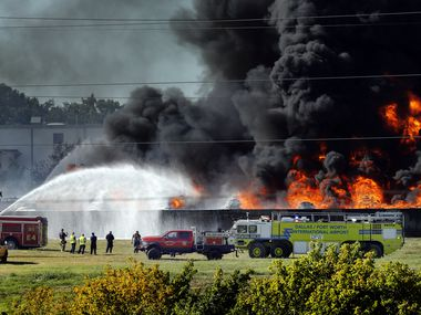 Grand Prairie and D/FW Airport firefighters douse burning plastic which caught fire at Poly-America at 2000 West Marshall Drive in Grand Prairie, Texas, Wednesday, August 19, 2020.