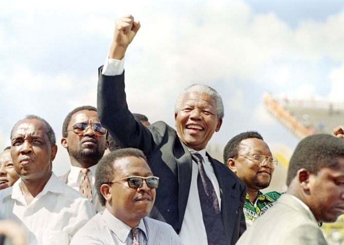 A clenched fist and a charismatic smile were hallmarks of Nelson Mandela, South Africa's first black president.