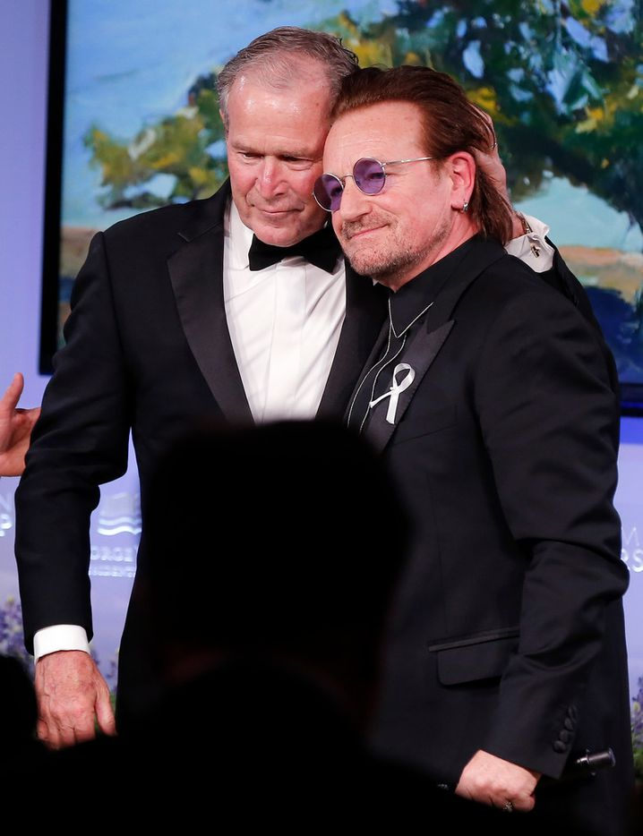 Former President George W. Bush, left, and musician Bono stand together during a gala for the Forum on Leadership at the George W. Bush Institute, Thursday, April 19, 2018, in Dallas. President Bush presented Bono with a medal of Distinguished Citizenship. (AP Photo/Brandon Wade)