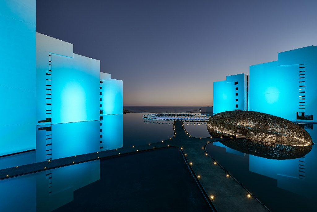 With the hotel exterior lit up at night, Mar Adentro has an otherworldly look. The modern buildings seem to float on a propertywide reflecting pool.