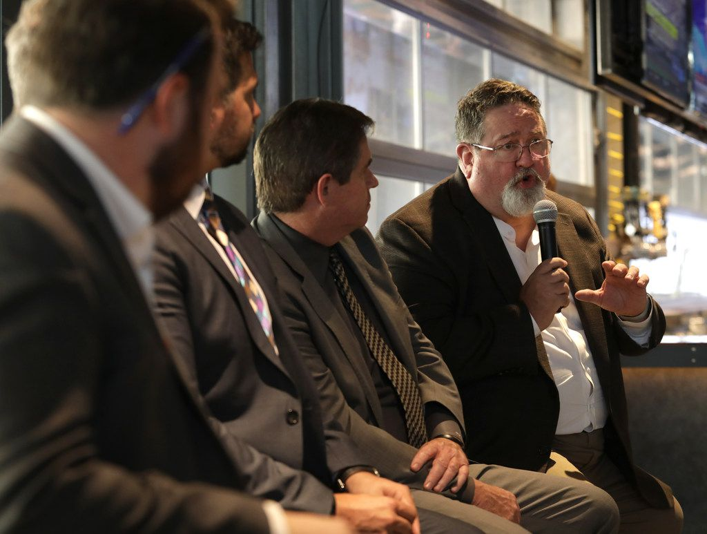 Neil Matkin (right), Collin College district president, said that for Collin County to grow appropriately, smart construction is key. For example, the college builds parking garages in a way that they can be converted to other uses if needed, he said.