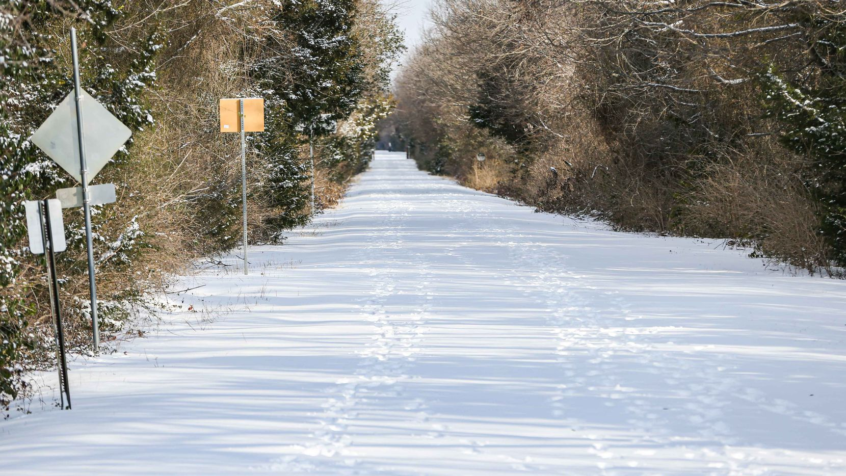 The Santa Fe Trail near Garland Rd covered in snow as a winter storm brings freezing temperatures to North Texas on Feb. 15, 2021, in Dallas.