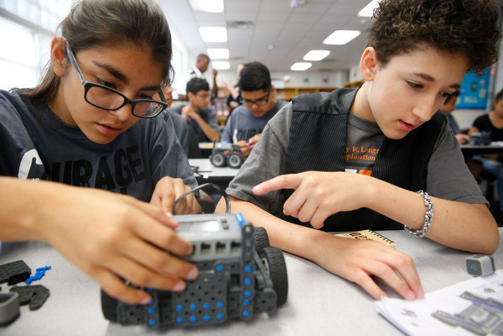 Maria Martinez, 14, (left) and Neryce MacWilliam, 12, put together a VEX robot as students from Westpoint assist DISD stem camp at Henry W. Longfellow Career Exploration Academy in Dallas June 7 ,2017.