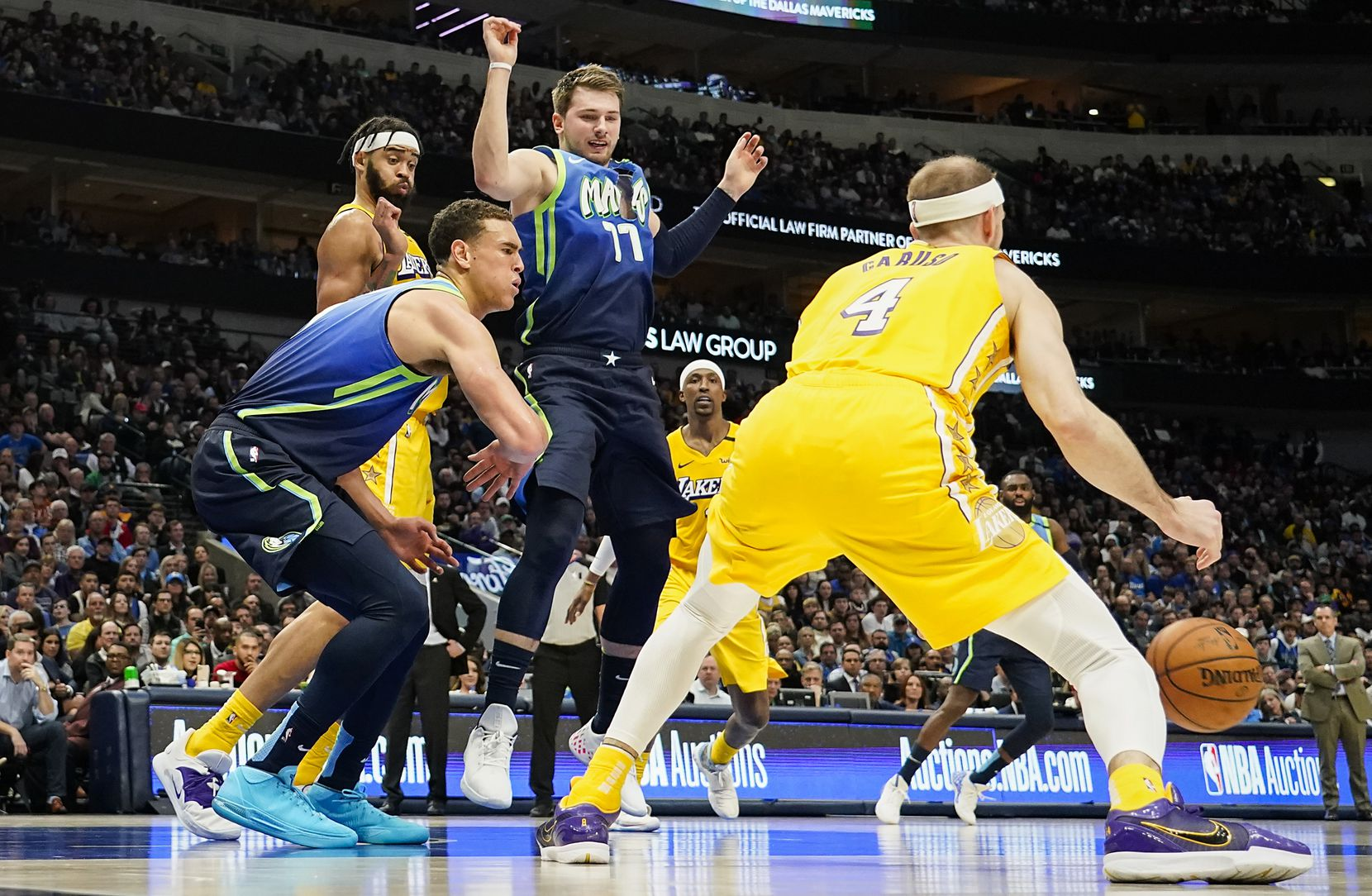 Dallas Mavericks guard Luka Doncic (77) plays with a ripped jersey late in the during second quarter of an NBA basketball game against the Los Angeles Lakers at American Airlines Center on Friday, Jan. 10, 2020, in Dallas.