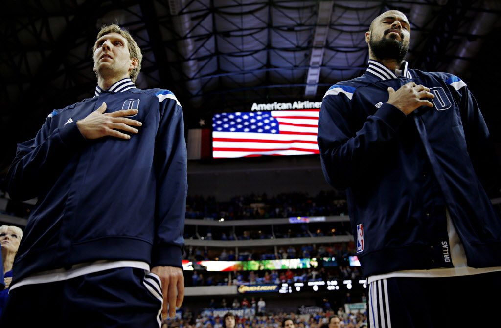 Dallas Mavericks forward Dirk Nowitzki (left) and center Tyson Chandler pause for the national anthem before their game against the Utah Jazz Oct. 30, 2014 at the American Airlines Center in Dallas, Texas.