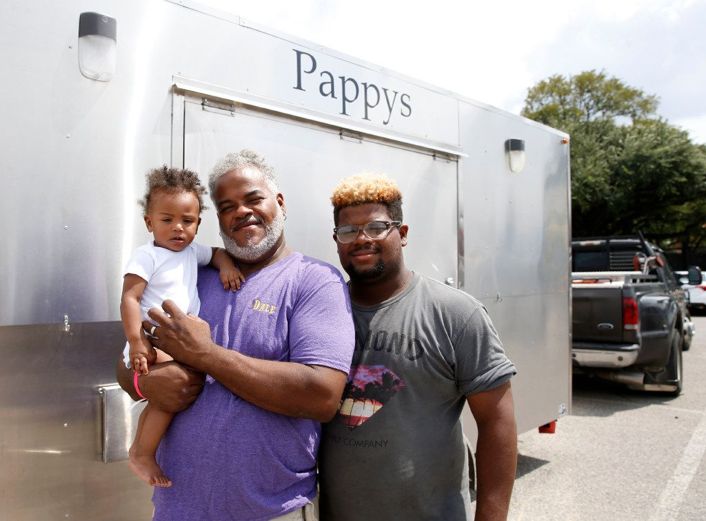 Dale Poullard, holding his 9-month-old granddaughter, Stormie Fontenot, and 17-year-old son Dustin Poullard brought their food trailer with them.