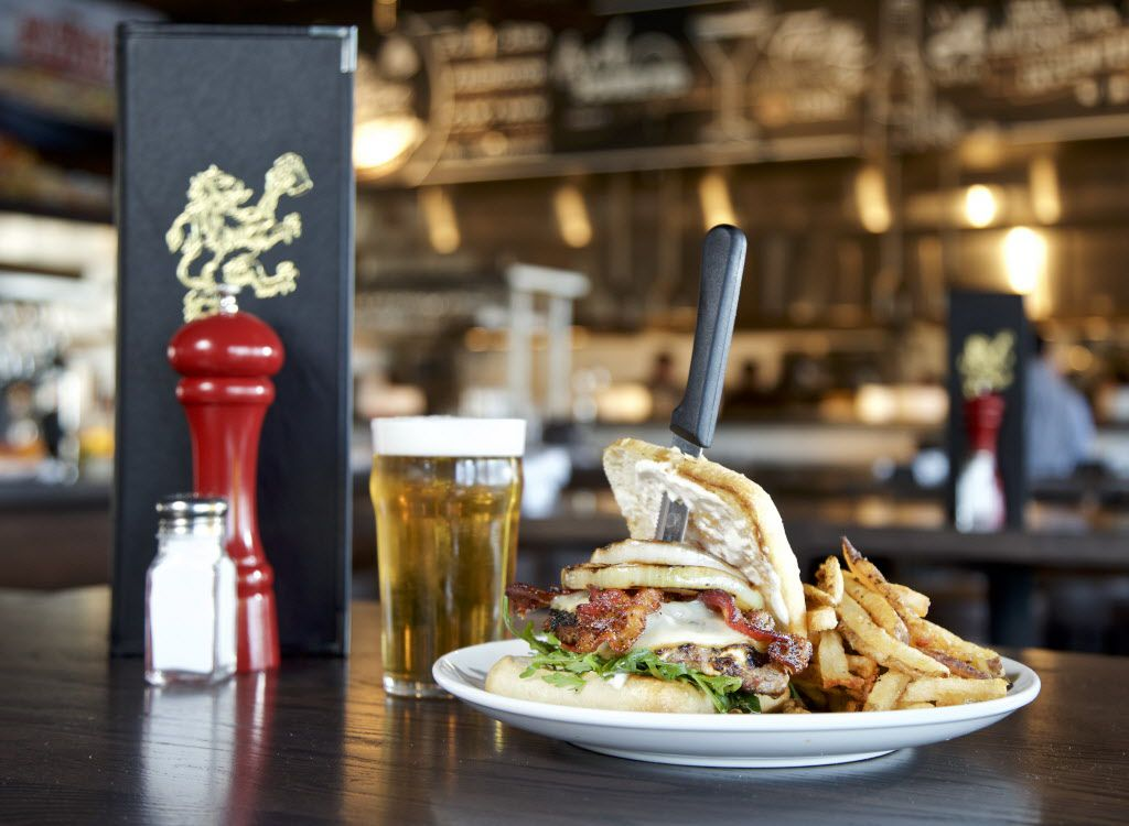 The Gastropub Burger, Gorgonzola infused burger with grilled sweet onion, maple pepper bacon, white cheddar, arugula and a horseradish cream, with fries at the Thirsty Lion Gastropub in Las Colinas. Mouth watering yet?