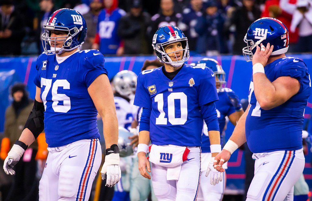 New York Giants quarterback Eli Manning (10) walks off the field after turning the ball over on downs during the final minutes of an NFL football game against the Dallas Cowboys at MetLife Stadium on Sunday, Dec. 30, 2018, in East Rutherford, New Jersey. The Cowboys won the game 36-35. (Smiley N. Pool/The Dallas Morning News)