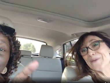 In this framegrab, Iris Meda, 70, left, sings along to songs in the car with her friend Rehna Troutt, right. Meda died Nov. 14 after contracting COVID-19.