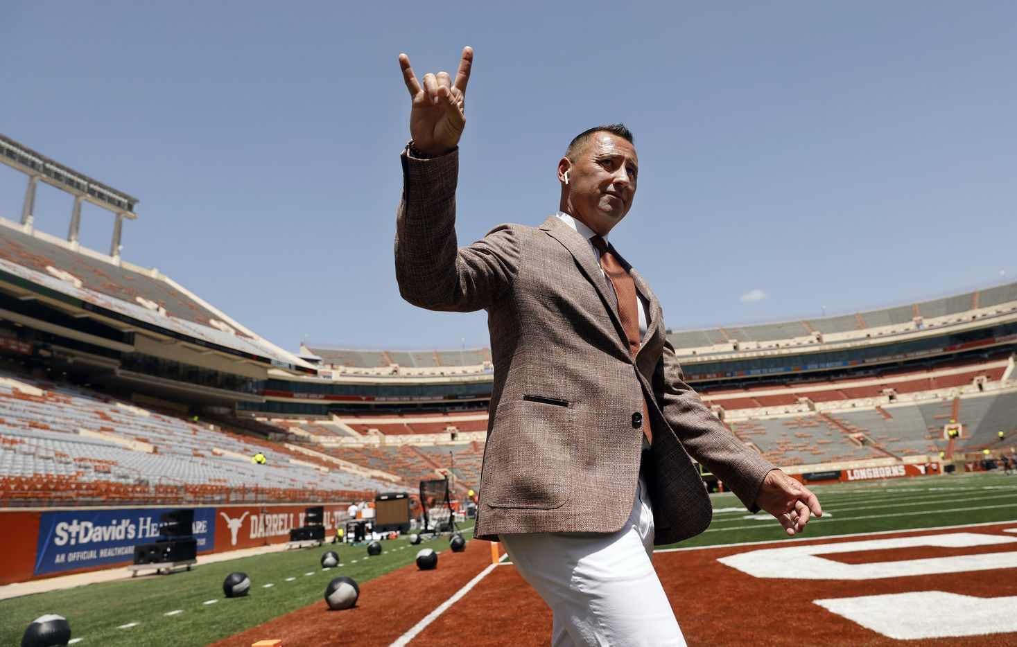 Texas Longhorns head coach Steve Sarkisian gives the Hook'em Horns hand sign as he paces the field before their game against the Louisiana-Lafayette Ragin Cajuns at DKR-Texas Memorial Stadium in Austin, Saturday, September 4, 2021. It's a tradition of his to not go in the locker room right when he gets to the stadium. (Tom Fox/The Dallas Morning News)