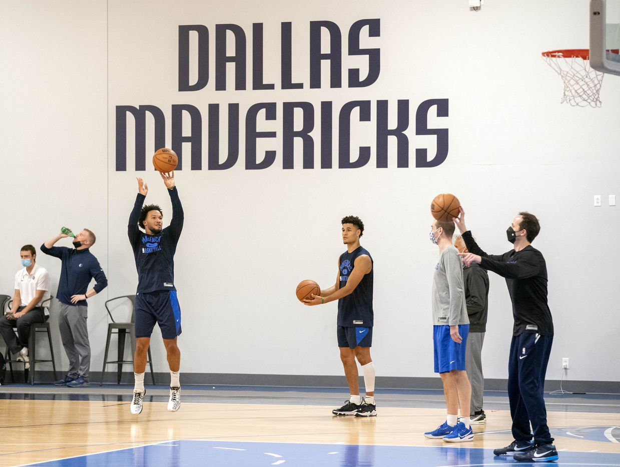 Dallas Mavericks guards Jalen Brunson, left, and Josh Green, right, participate in a shooting drill during a training camp practice Wednesday, September 29, 2021 at the Dallas Mavericks Training Center in Dallas. (Jeffrey McWhorter/Special Contributor)