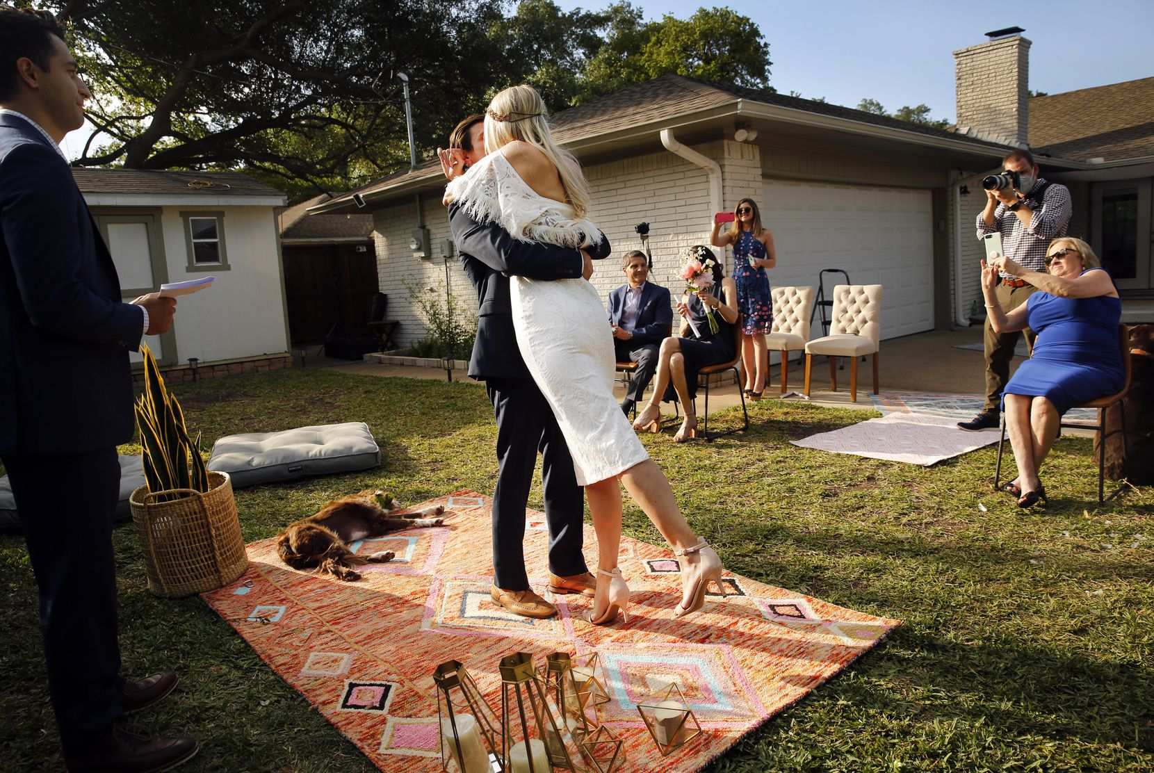 Andrew Houshian and Dana Striph sealed it with a kiss after Kayvon Rashidi married them at their northeast Dallas home in April. Tucker, their springer spaniel, was the ring bearer