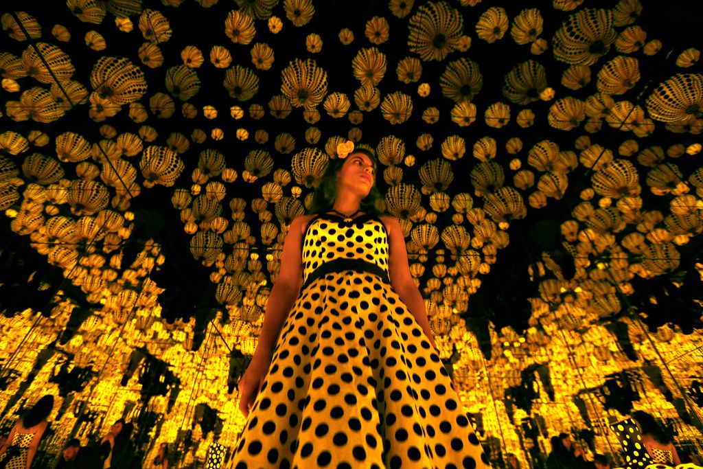 Lyza Hernandez looks at Yayoi Kusama's installation: 'All the Eternal Love I Have for the Pumpkins,' at the Dallas Museum of Art in Dallas on Sept. 22, 2017.