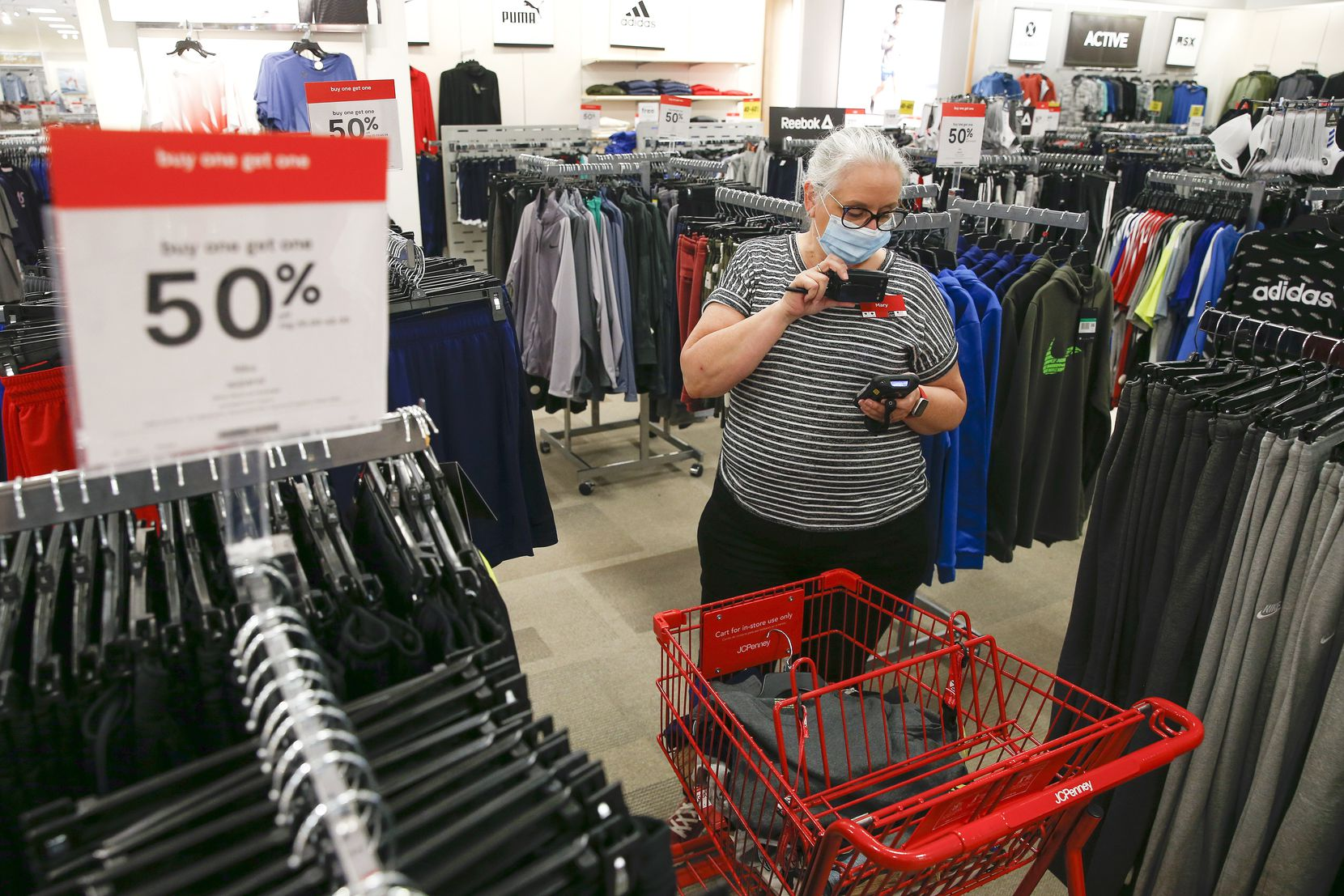 Mary Wagner, a visual merchandiser at J.C. Penney, prepares a curbside order on May 1 at the store in Fairview.