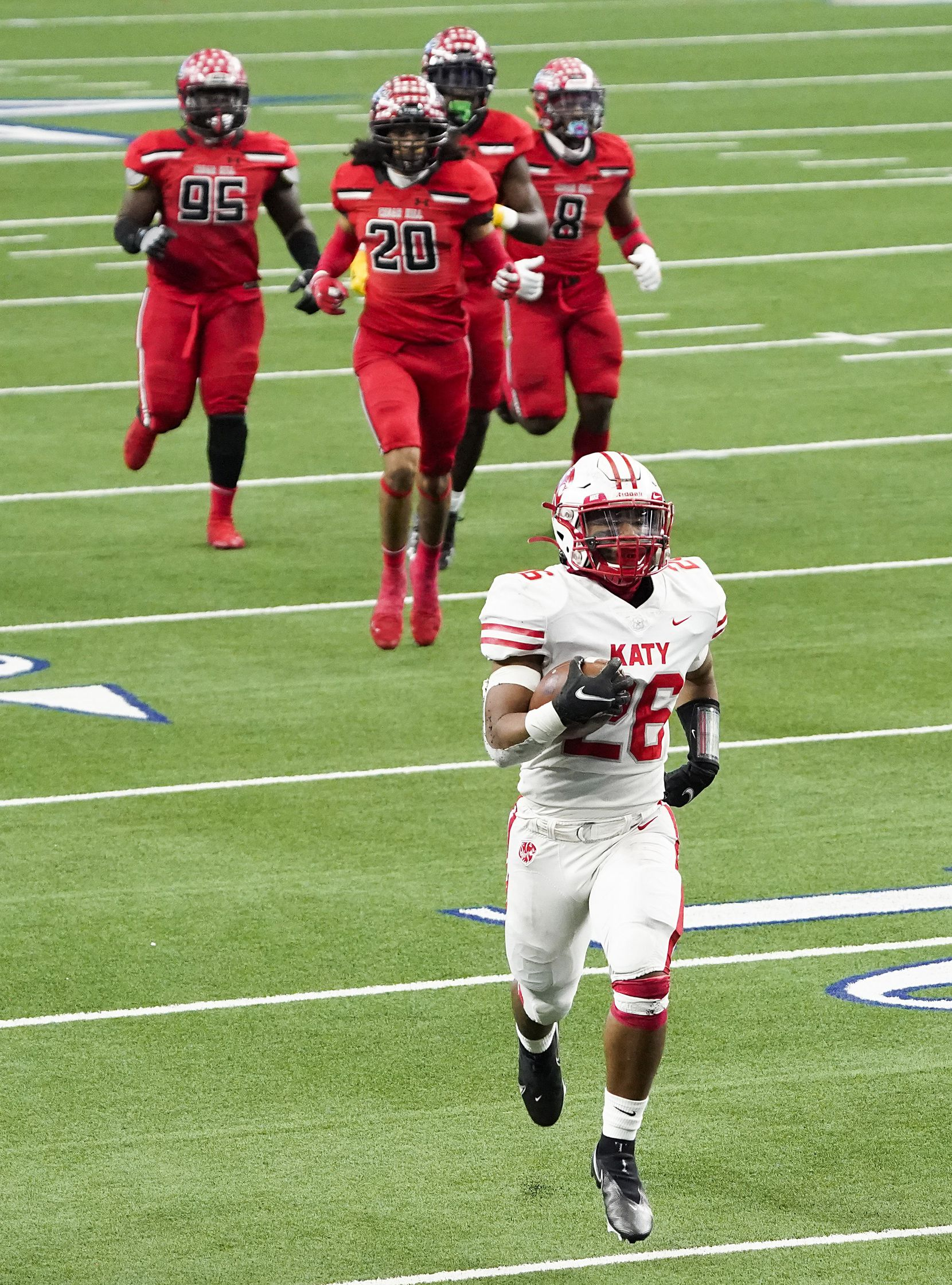 Katy running back Isaiah Smith (26) runs for a 55-yard touchdown leaving Cedar Hill defenders, including Tarren Black (95), Brian Willis, Jr (23) and Stefan Ingram (8), behind during the first half of the Class 6A Division II state football championship game at AT&T Stadium on Saturday, Jan. 16, 2021, in Arlington, Texas.