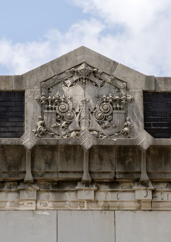 Carved stone trim on top of one of the Commerce Street buildings.