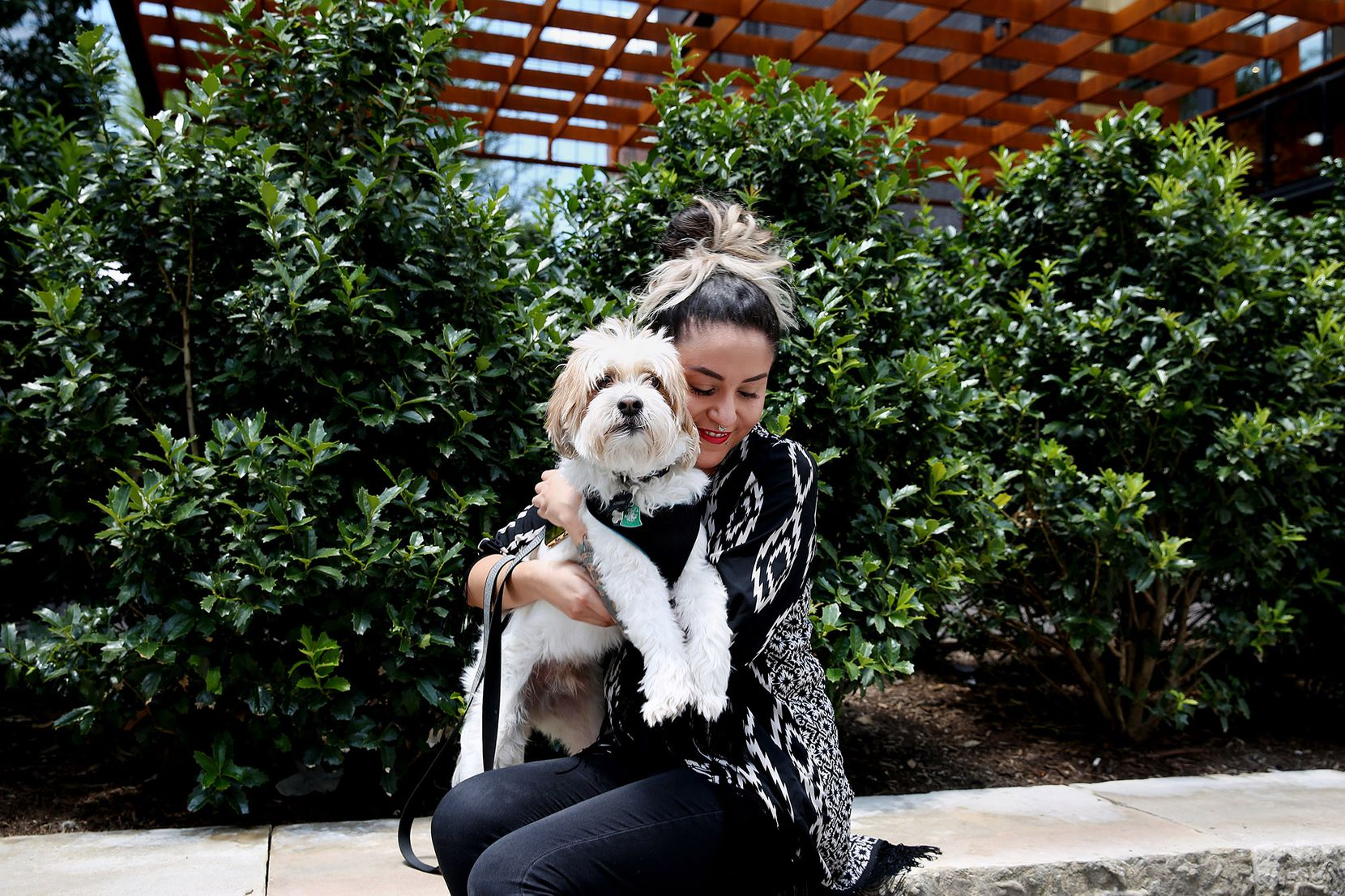 Missy Monoxide, her artist name, sits for a photograph with her dog Armani along Main Street on  July 10.