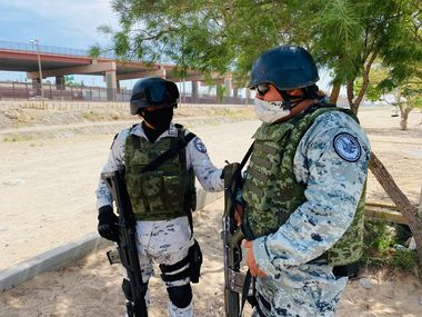 Mexico national guardsmen, seen here last week, say they pick a key location along the Mexican side of the border and try to serve as a deterrence to migration.