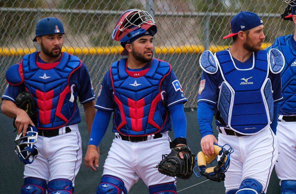 Texas Rangers catchers (from left) Isiah Kiner-Falefa, Jose Trevino and Jeff Mathis prepare to catch a bullpen session during a spring training workout at the team's training facility on Thursday, Feb. 14, 2019, in Surprise, Ariz.. (Smiley N. Pool/The Dallas Morning News)