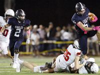 Episcopal School of Dallas sophomore running back Collin Nicholson (5) runs over Houston St. Johns defenders from a wildcat formation during the second half of a Friday night football game at Gene and Jerry Jones Stadium on the campus of Episcopal School of Dallas, Oct. 22, 2021.