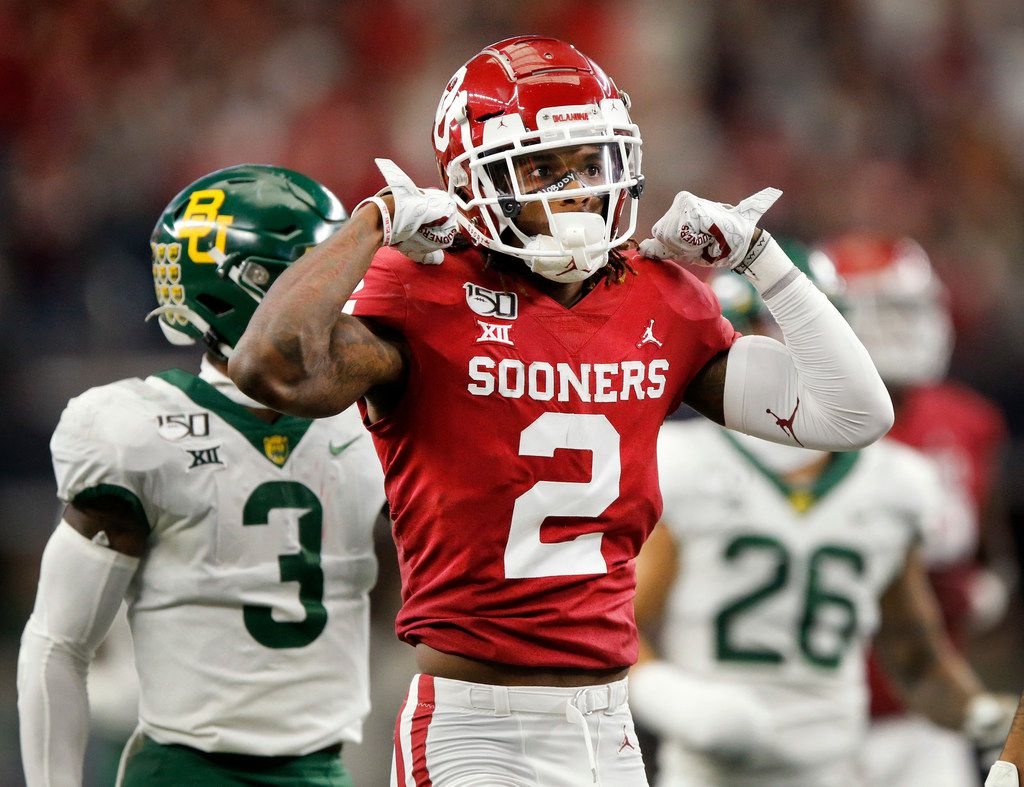 Oklahoma Sooners wide receiver CeeDee Lamb (2) flexes his muscles after he took a hit on a first quarter pass reception against the Baylor Bears in the Big 12 Championship at AT&T Stadium in Arlington, Saturday, December 7, 2019. (Tom Fox/The Dallas Morning News)