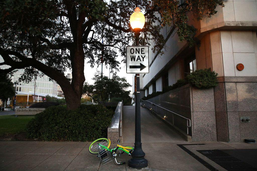 A LimeBike rental bike was abandoned along Houston Street in Dallas on Oct. 30, 2017.