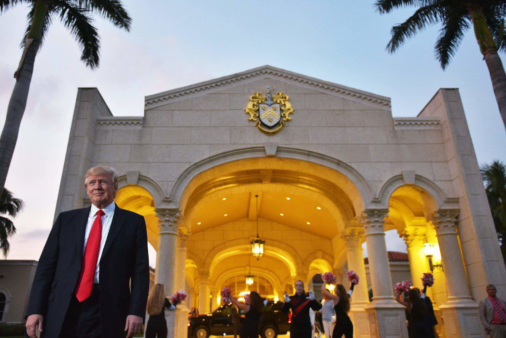 US President Donald Trump watches the Palm Beach Central High School marching band perform as it greets him upon his arrival to watch the Super Bowl at Trump International Golf Club Palm Beach in West Palm Beach, Florida on February 5, 2017.