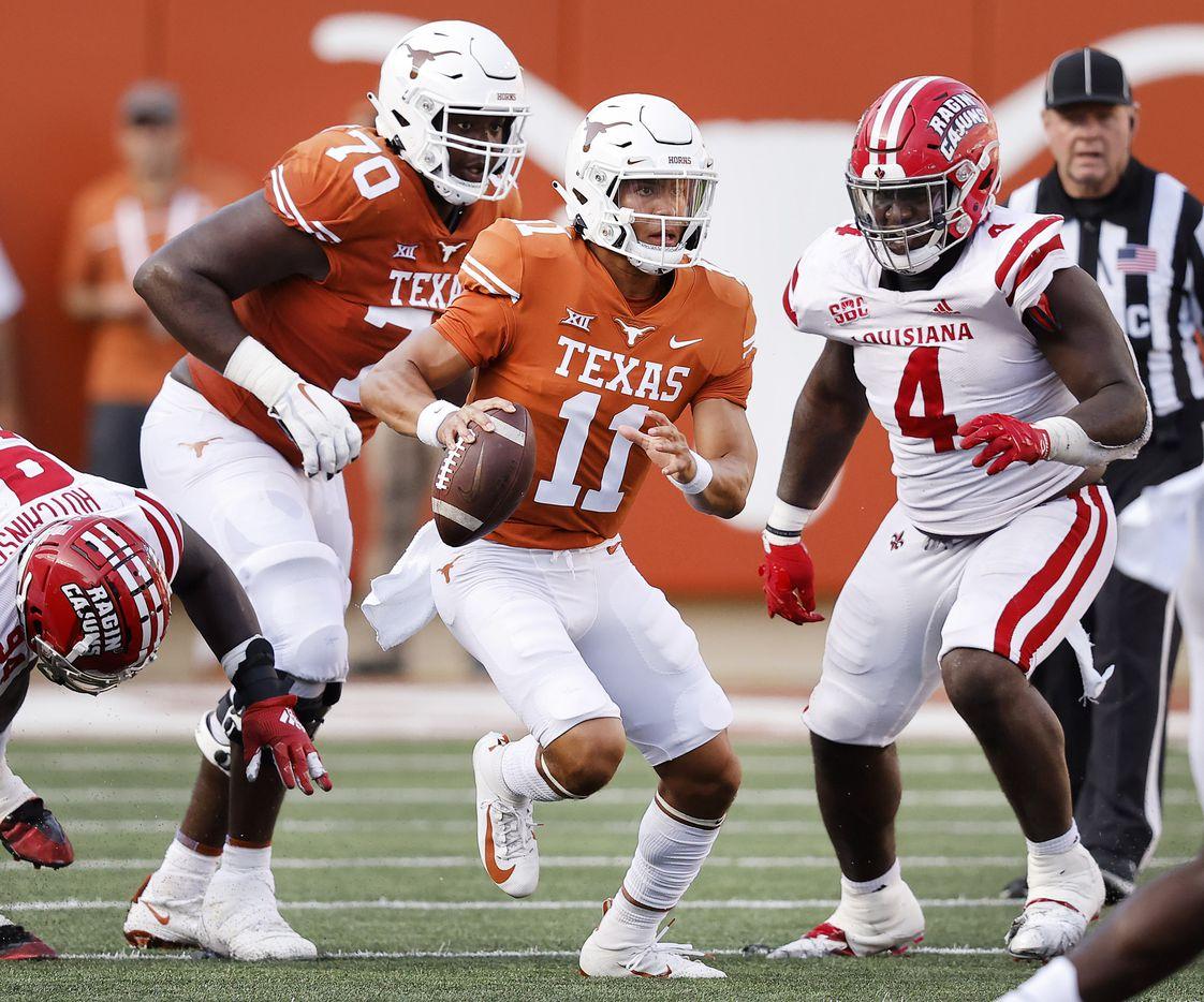 Texas Longhorns quarterback Casey Thompson (11) escapes the Louisiana-Lafayette Ragin Cajuns defensive rush during the fourth quarter at DKR-Texas Memorial Stadium in Austin, Saturday, September 4, 2021. (Tom Fox/The Dallas Morning News)