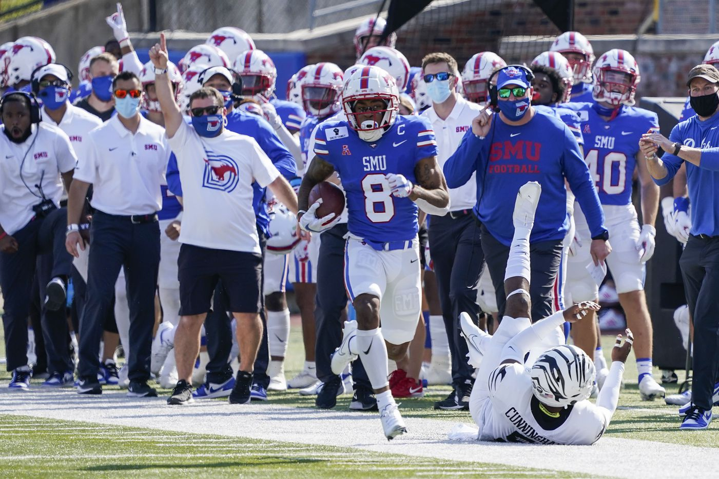 SMU wide receiver Reggie Roberson Jr. gets past Memphis defensive end Everitt Cunningham as he races 85-yards for a touchdown during the first half of an NCAA football game at Ford Stadium on Saturday, Oct. 3, 2020, in Dallas.