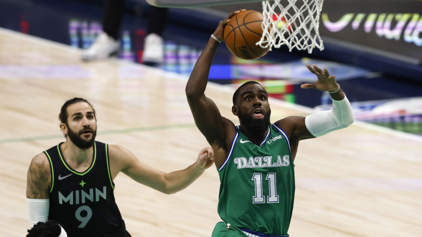 Dallas Mavericks guard Tim Hardaway Jr. (11) dunks the ball in front of Minnesota Timberwolves guard Ricky Rubio (9) during the first quarter of play at American Airlines Center on Monday, February 8, 2021 in Dallas.
