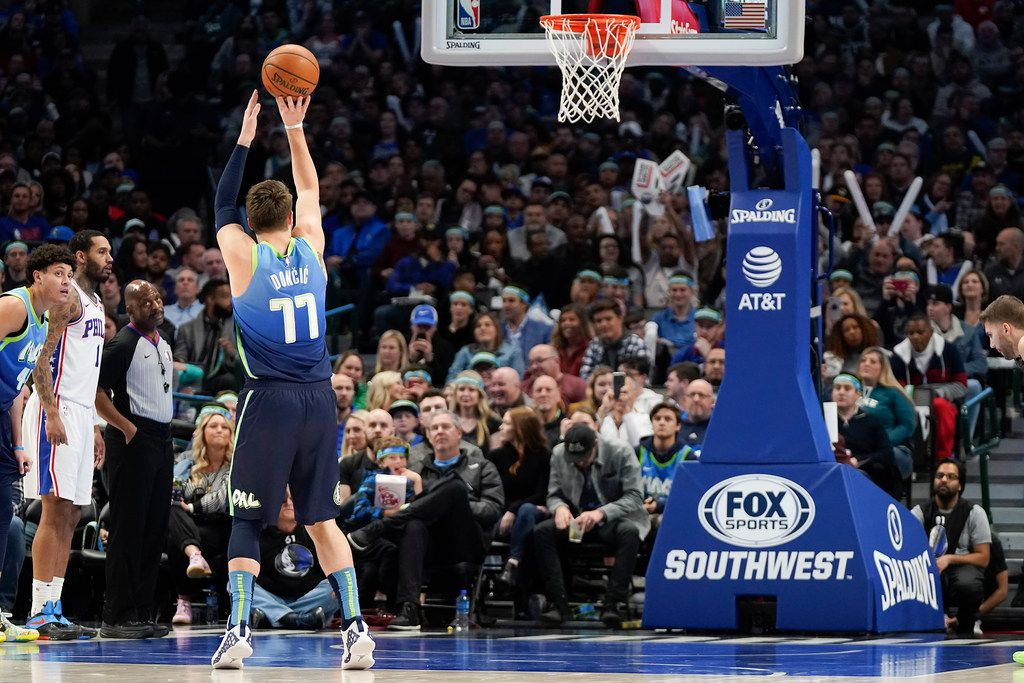 Dallas Mavericks forward Luka Doncic (77) shoots a free throw during the first half of an NBA basketball game against the Philadelphia 76ers at American Airlines Center on Saturday, Jan. 11, 2020, in Dallas.