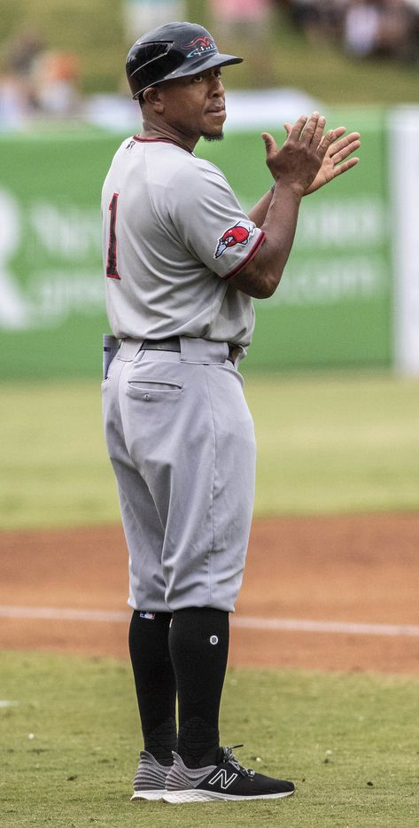 Hickory Crawdad's manager Joshua Johnson coaches third base during the game with the Greensboro Grasshopper's at First National Bank Field on Friday, August 6, 2021 in Greensboro, N.C. (Woody Marshall/Special Contributor)