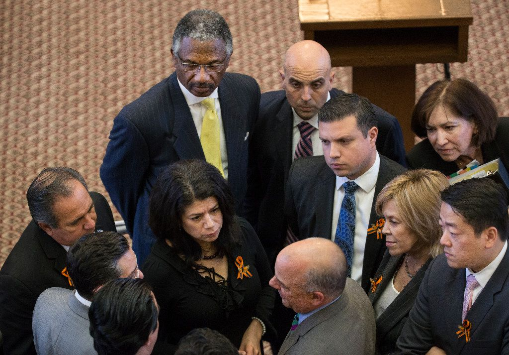 Democrats huddle on the House floor to discuss a deal to end the debate or continue the fight against a bill to ban sanctuary cities.