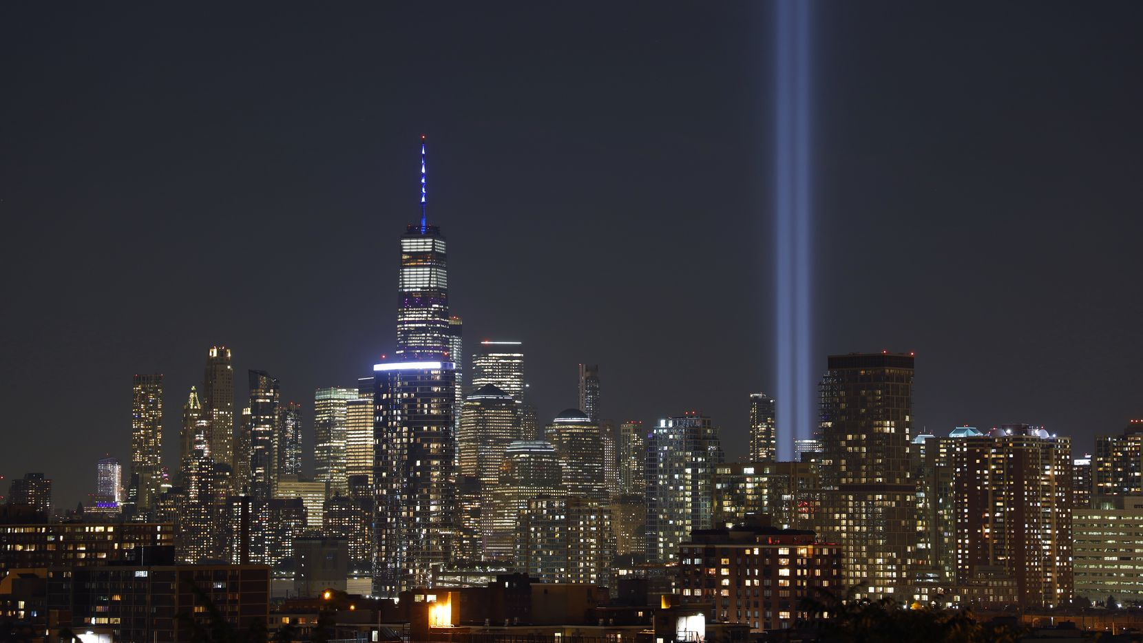 The annual Tribute in Light is illuminated on the skyline of lower Manhattan on the 18th anniversary of the 9/11 attacks in New York City on September 11, 2019 as seen from Jersey City, New Jersey. A self-guided 9/11 memorial will take place this weekend in McKinney.
