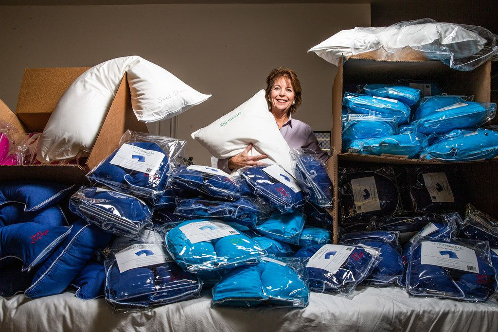 Merrimac Dillon poses for a photograph with her pillows at the Pillow Bar in Dallas.