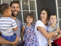Ryan and Taylor Hollingshead and their children Huck (right), 4, Quinn (center), 3, and 2-year-old foster son pose for a portrait at their home in Richardson. Ryan and Taylor have been foster parents since 2019 and requested that their foster son's face and name not be used before the process is finalized.