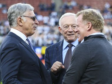 Los Angeles Rams owner Stan Kroenke, left, Dallas Cowboys owner Jerry Jones and NFL Commissioner Roger Goodell  prior to a NFC divisional playoff game between the Dallas Cowboys and the Los Angeles Rams on Saturday, Jan. 12, 2019 at Los Angeles Memorial Coliseum in Los Angeles.